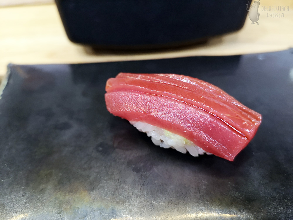 Nigiri with intense red tuna, topped with a little sauce.