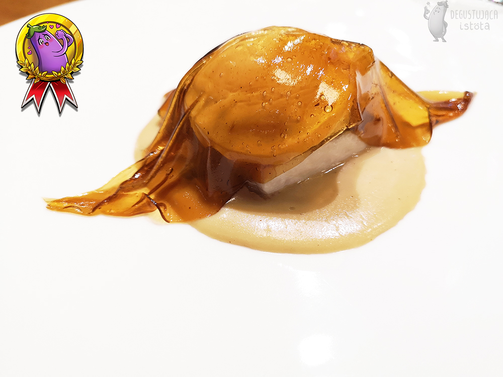 A mushroom piece of jelly covers the egg under which is a piece of sturgeon.